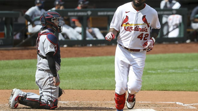 Indians catcher Roberto Perez, left, looks on as the St. Louis Cardinals' Dexter Fowler scores on a solo home run during the seventh inning Sunday in St. Louis.