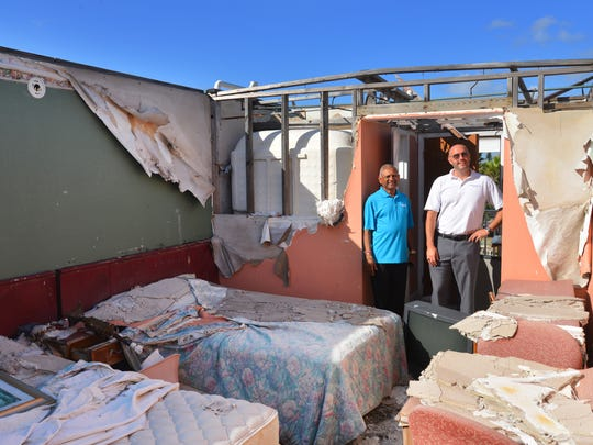 Vinu Patel, owner of the property and Marshall Copley, with Jacobson Auction & Realty Co.  out of Ft. Pierce survey the damage to the third floor of the Beach House Motel. The motel, just north of Nance Park in Indialantic on A1A , was severely damaged by Hurricane Irma and a tornado during that storm that took the roof off the three story building. The landmark motel was was built in the late '50s and has been owned by Vinu Patel since 2006.  The motel and property is up for auction on October 20th.