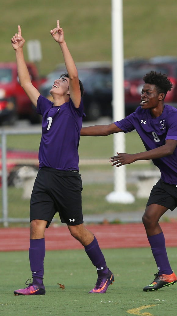 New Rochelle's Cristian Valencia (7) celebrates with