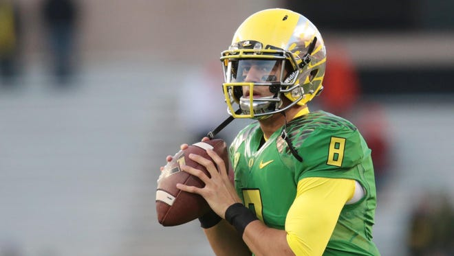 Oregon Ducks quarterback Marcus Mariota (8) warms up before the game against the Oregon State Beavers at Reser Stadium.