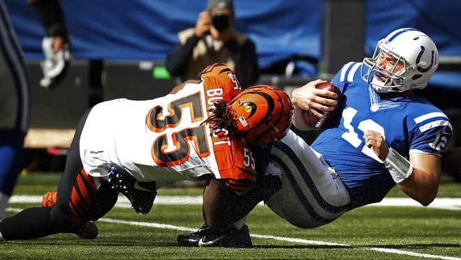 Cincinnati Bengals outside linebacker Vontaze Burfict (55) tackles Indianapolis Colts quarterback Andrew Luck (12) in the first quarter at Lucas Oil Stadium.
