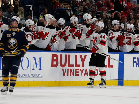 New Jersey Devils left wing Miles Wood (44) celebrates