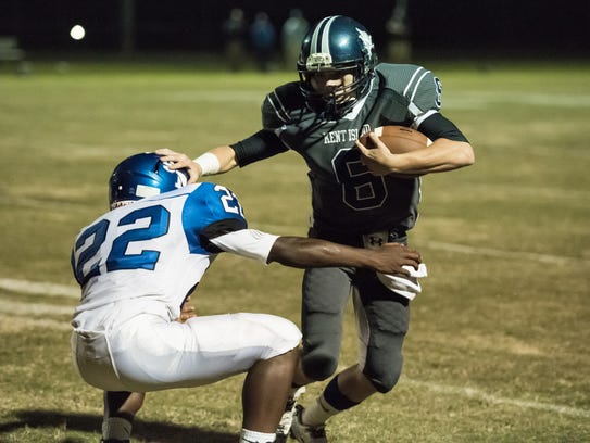 Kent Island's Sean Mooney, right, attempts to run the