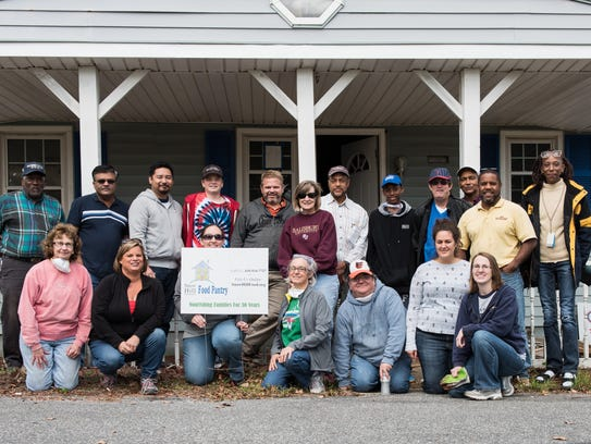 A group shot of the volunteers and staff outside the