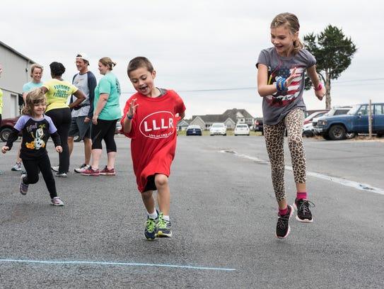 Benjamin Schultheis, 5, of Fruitland races Kayla Colling,
