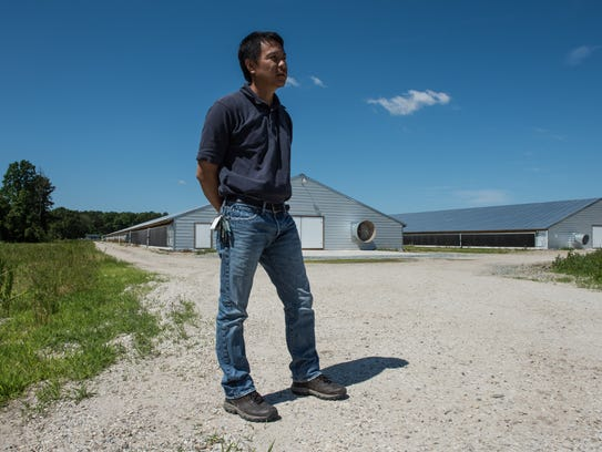 Poultry farm owner, Minh Vinh, at his facility on College