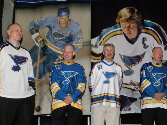 Former St. Louis Blues greats Keith Tkachuk, Joe Mullen, Gary Unger and Red Berenson, from left, are honored at a ceremony for the players, who wore No. 7, before the NHL hockey game between the Blues and the Columbus Blue Jackets, Monday, March 7, 2011 in St. Louis. Mullen's son, Patrick, is now with the Rochester Americans.