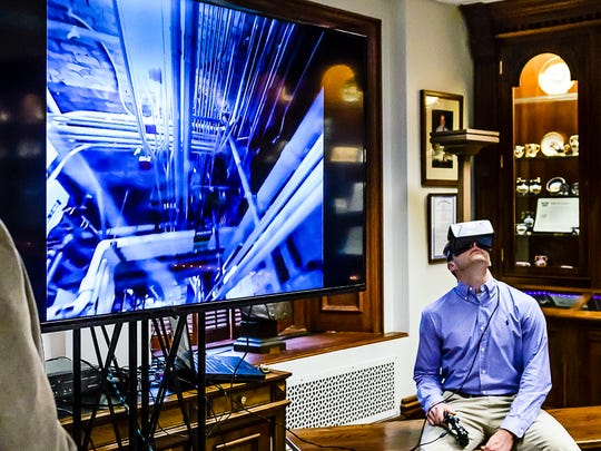 Dave Russell, a Christman Project Engineer, uses virual reality googles that are synced with a 360' robotic camera to tour areas that are too small for humans to venture into during the Guts of the Capitol tour Thursday October 6, 2016 at the Michigan State Capitol building in Lansing.  KEVIN W. FOWLER PHOTO