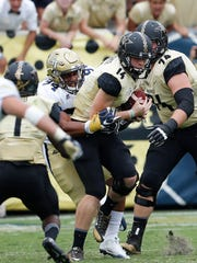 Vanderbilt quarterback Kyle Shurmur (14) tries to scape the grasp of Georgia Tech defensive lineman Anree Saint-Amour (94) in the second half of last Saturday's game in Atlanta. Georgia Tech won 38-7.