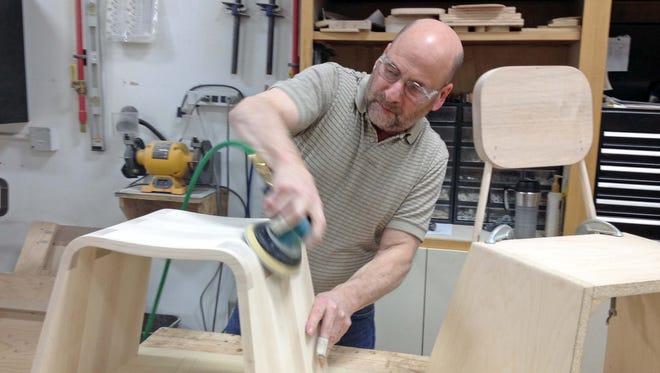Nemschoff R&D technician Richard Sprengel sands a chair at Nemschoff in Sheboygan in this file photo.