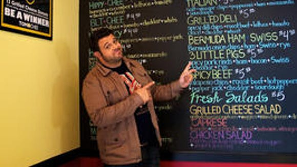 Adam Richman at Tom + Chee in 2011