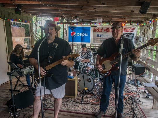 The River Rats perform Sunday, Aug. 27, at Jake's Fish Camp in Burkville. From left, the River Rats band members are Beverly Palmer, Andy Norman, Tommy Beavers and Ray Goss.