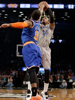 Brooklyn Nets' Paul Pierce (34) shoots over New York Knicks' J.R. Smith (8) during the first half of an NBA basketball game Tuesday, April 15, 2014, in New York.