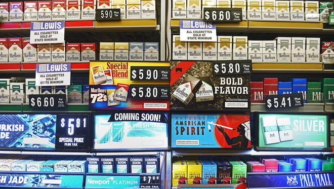 Tobacco products on display behind the counter at Lewis Drug Monday, June 19, 2017, in Sioux Falls.