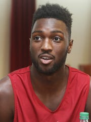 FILE - In this Nov. 2, 2015, file photo, Oklahoma forward Khadeem Lattin speaks to reporters during NCAA college basketball media day in Norman, Okla.
