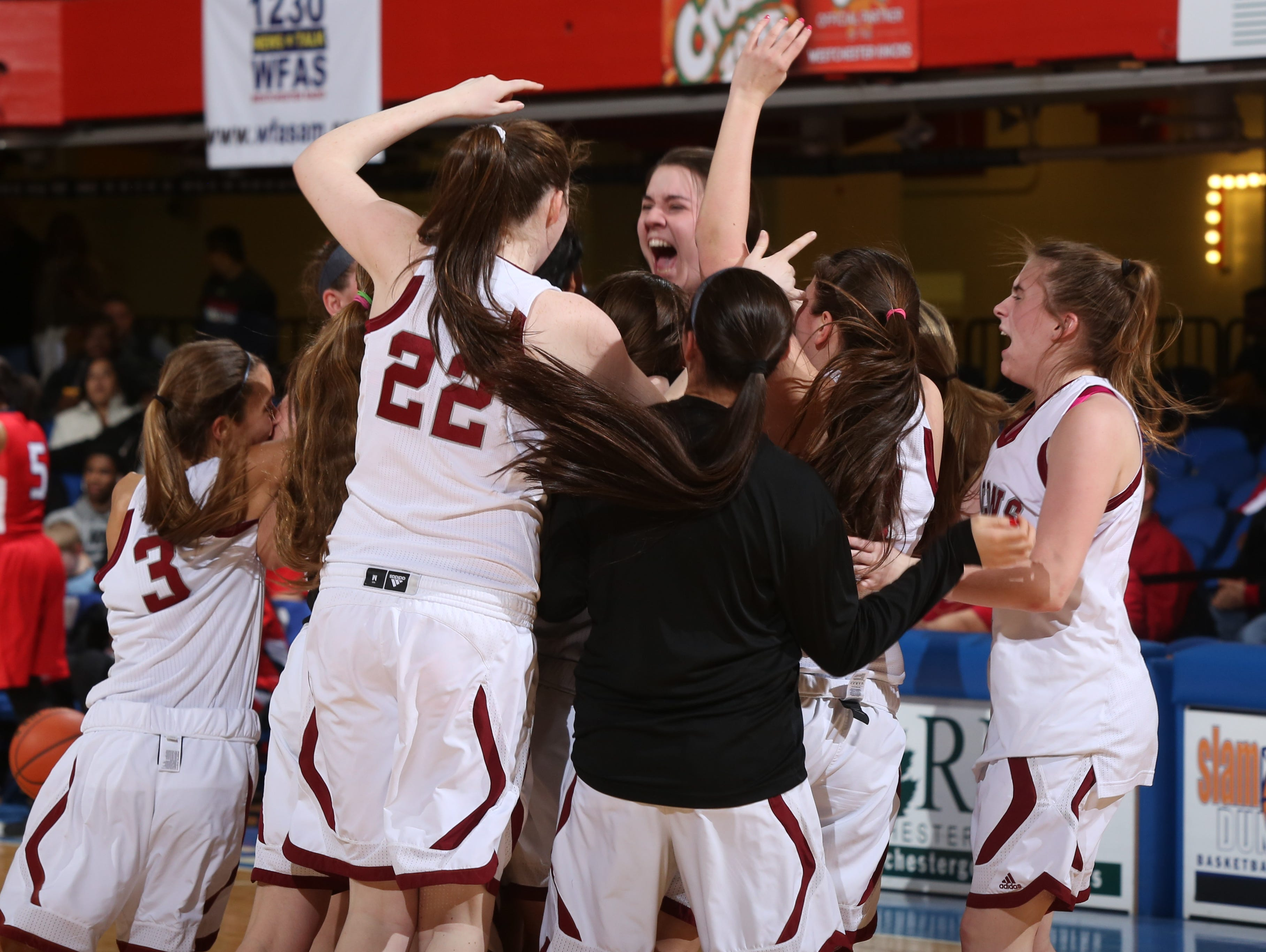Albertus Magnus celebrates their 56-49 win over Peekskill during the Class A girls basketball final at the Westchester County Center in White Plains March 2, 2015.