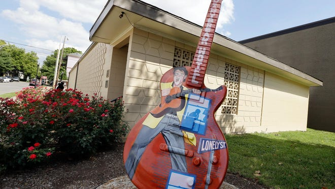 A guitar painted with the likeness of Elvis Presley stands outside RCA Studio B in Nashville, where Presley recorded.