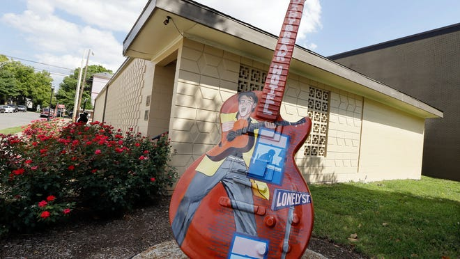 In this Aug. 8, 2014, file photo, a guitar painted with the likeness of Elvis Presley stands outside RCA Studio B in Nashville, where Presley recorded during his career.