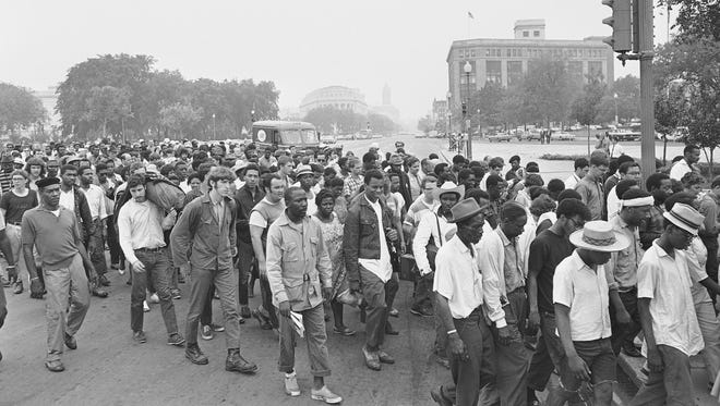Participants in the Poor People's Campaign, walk peacefully toward the Capitol in Washington, June 24, 1968.  Ralph Abernathy and his followers from Resurrection City marched to the Agriculture Department and then tried to assemble on the grounds of the Capitol. (AP Photo)