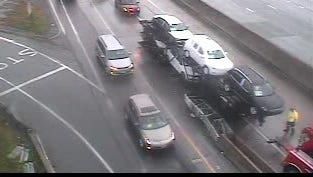 Traffic crawls past a car carrier that had been in an accident on southbound Interstate 95 at Exit 16 for Cedar Street in New Rochelle, July 29, 2016, as seen on a state Thruway Authority traffic camera image.