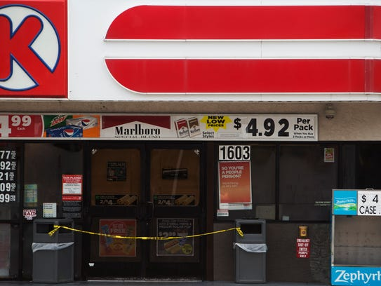 Crime scene tape blocks the entrance to a Circle K