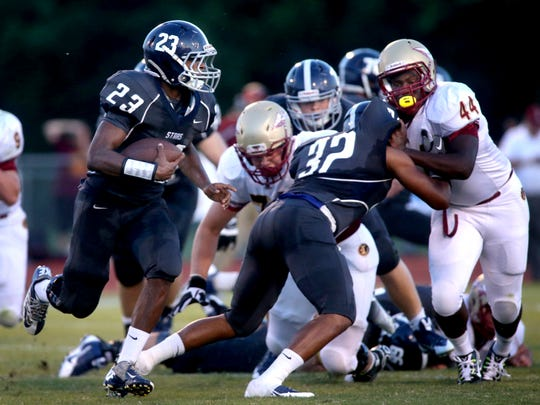 Siegel's Greedy Howse runs the ball against Riverdale during the season opener.