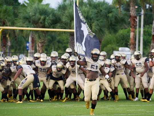 Treasure Coast High School's football team plays Jensen Beach in a spring game on May 19.