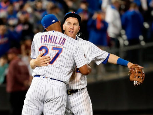 New York Mets' Todd Frazier, right, hugs Jeurys Familia (27) after a baseball game against the Milwaukee Brewers, Friday, April 13, 2018, in New York. (AP Photo/Frank Franklin II)