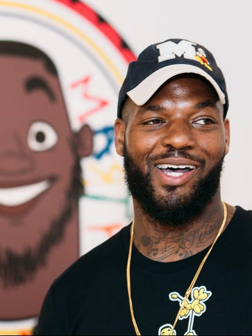 BOSTON, MA - JUNE 17:  Martellus Bennett stands in front of his animated portrait during the Hey AJ Imagination Lounge Pop Up on June 17, 2016 in Boston, Massachusetts.  (Photo by Natasha Moustache/Getty Images for Martellus Bennett- Imagination Agency Pop Up Book Launch) ORG XMIT: 648090201 ORIG FILE ID: 541009760