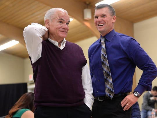 Then-Ingham County Sheriff candidate Scott Wriggelsworth, right, talks with his father Gene L. Wriggelsworth, then-Ingham County Sheriff, at his watch party on Tuesday, Nov. 8, 2016, at the UA Local 333 Plumbers and Pipefitters union hall in Lansing.
