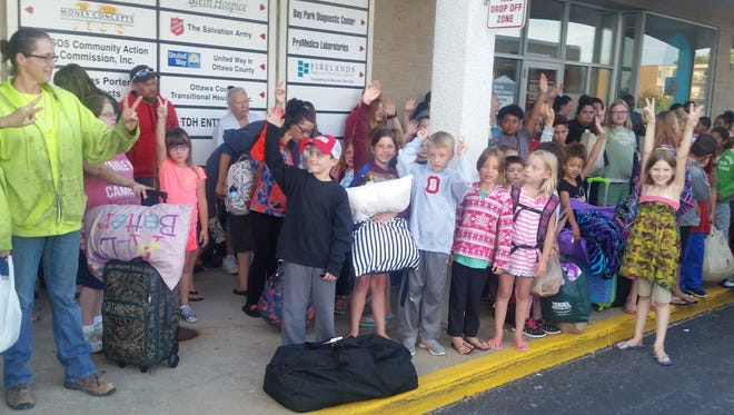 Seventy-four children get ready to depart for the Salvation Army's Camp NEOSA.
