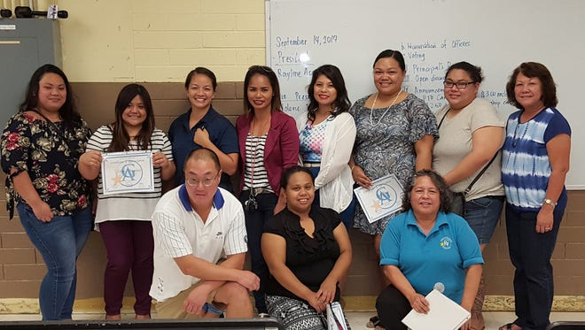 On Sept. 14, Guahan Academy Charter School new school year officers were elected by the Parents Teachers Organization (PTO).  Pictured front row from left: Mike Soderquist, treasure; Tierra Siguenza, former treasure and Principal Mary Mafnas. Back row from left: Mona Santos, communications secretary; Robelyn Bagaoisan, former record secretary; Sheila Blas, record secretary; Judy Adriano, former vice president; Jolene Toves, vice president; Josett Cruz, former president; Rayline Asosta, president and Assistant Principal, Teresita Cruz.