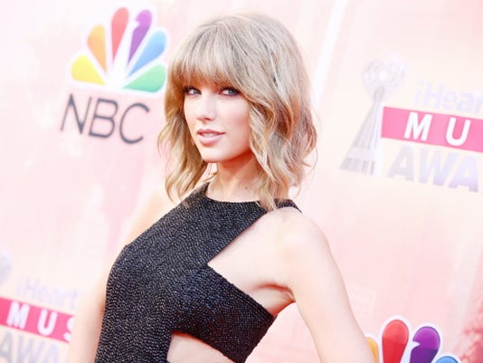 "FILE - In this March 29, 2015 file photo, Taylor Swift arrives at the iHeartRadio Music Awards at The Shrine Auditorium in Los Angeles.  Swift's mega-selling ""1989"" album earned her a nomination for top artist at the 2015 Billboard Music Awards. Swift's competition includes Sam Smith, Ariana Grande, One Direction and Katy Perry. Ludacris and Pete Wentz announced some of the nominees Tuesday, April 7, 2015 on ""Good Morning America."""