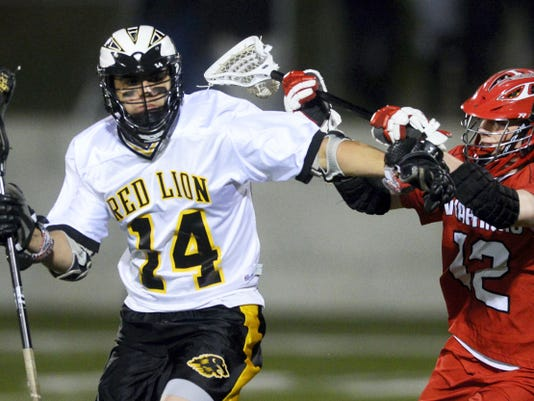 Susquehannock's Collin Kelly defends against Red Lion's Justin Dashler during a boys' lacrosse game at Red Lion Area High School on April 23. Red Lion handed Susquehannock its first YAIAA loss of the season, as the Lions topped the Warriors 17-8. With the victory, Red Lion moved to 8-2 in YAIAA play.