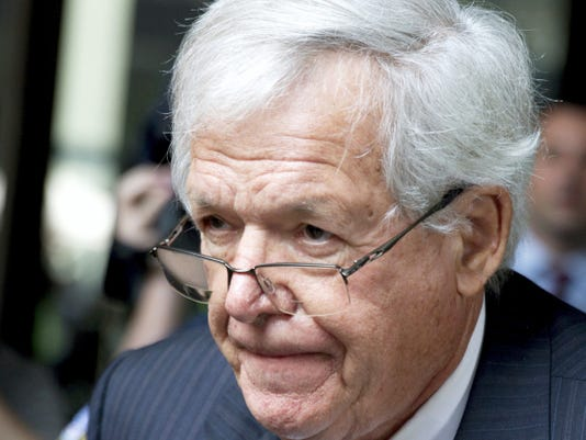 FILE - In this June 9, 2015, file photo, former House Speaker Dennis Hastert, right, departs the federal courthouse with attorney Thomas C. Green in Chicago. An attorney for Hastert told a federal judge that the former House speaker intends to plead guilty in a federal hush-money case during a hearing Thursday Oct. 15, 2015 in Chicago. Hastert attorney John Gallo said during the brief hearing that he expects to have a written plea agreement by Monday. And he asked the judge to set a date for a change of plea. The judge scheduled an Oct. 28 hearing. (AP Photo/Charles Rex Arbogast, File)