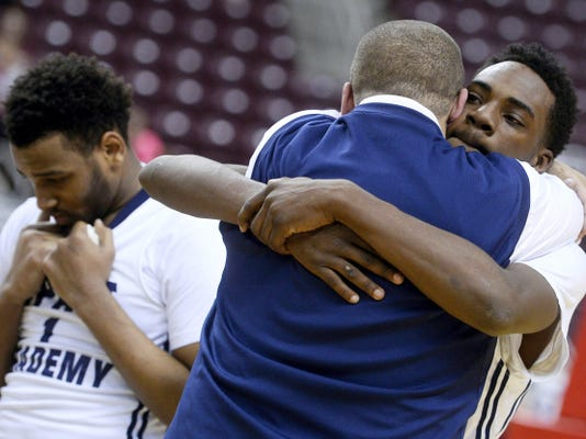 Elliott Wilson and coach David Archer hug Friday after Hilda Goodling Impact Academy won the District 3 Class A championship at Hershey's Giant Center. Impact qualified for the PIAA Class A tournament, which begins Friday, but withdrew on Tuesday.