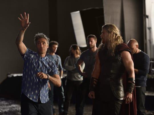Director Taika Waititi works on a scene with star Chris