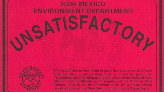 "A restaurant that does not pass inspection by the New Mexico Environment Department is given an ""Unsatisfactory"" grade. The sticker must be displayed until the restaurant passes inpection."