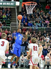 Southfield Christian junior Bryce Washington shoots against Powers North Central in Thursday's Class D semifinal at the Breslin Center. North Central won, 84-83, in double overtime.