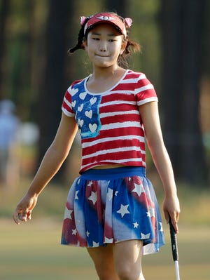 Lucy Li reacts to her putt on the 11th hole during the first round of the U.S. Women's Open golf tournament in Pinehurst, N.C., on Thursday.