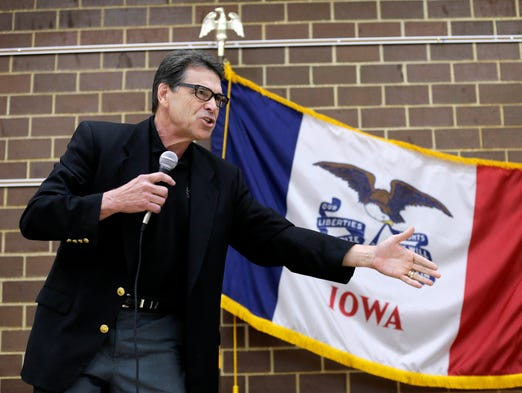 Texas Gov. Rick Perry speaks to local party activists, Saturday, July 19, 2014, in Algona, Iowa. After his presidential bid crashed in 2012, Iowans now have to decide whether to give Perry another spin. (AP Photo/Charlie Neibergall)