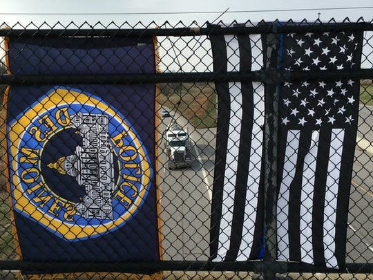 Flags on the University Avenue overpass in advance of the funeral procession for Des Moines Police Officer Susan Farrell on Wednesday, March 30, 2016.