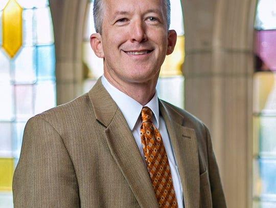 Timothy S. Huebner