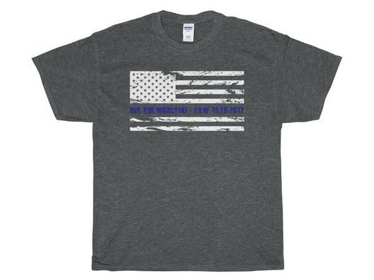 An Oconomowoc police officer helped create a shirt