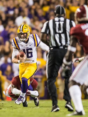 LSU Tigers quarterback Danny Etling (16) runs up the middle for the a 6 yard gain in the first quarter as the Alabama Crimson Tide play the LSU Tigers in Baton Rouge on Saturday night in Death Valley, November 5, 2016. BUDDY DELAHOUSSAYE/ THE ADVERTISER