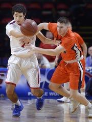 Fairport's Jordan Holmes, left, tips the ball away