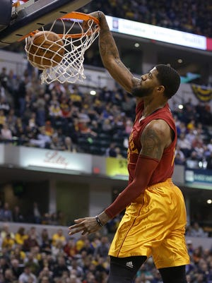 Indiana Pacers forward Paul George (13) slams down two points in the first half of their game Wednesday, April 6, 2016, evening at Bankers Life Fieldhouse.