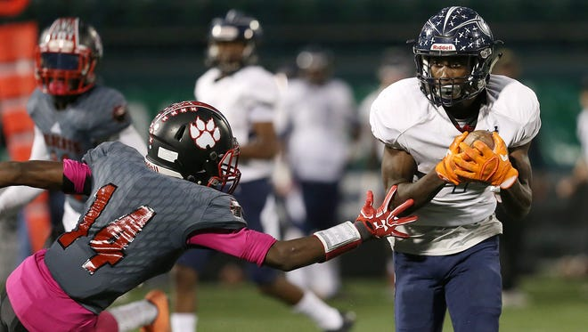 Eastridge wide receiver Rayshauid Smith, right, cuts back across the field and away from Wilson's Jah'kier Moore, left, on his way to running it in for a touchdown in the second quarter during their Class A first round playoff game at Capelli Sport Stadium in Rochester on Friday, Oct. 20, 2017.
