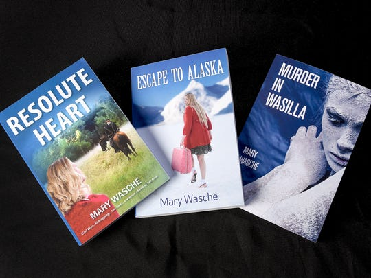 Author Mary Wasche, Isle, talks about her three books shown Monday, March 12.