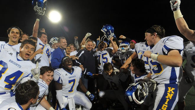 O'Gorman's head football coach Steve Kueter is surrounded by his team after defeating Rapid City Stevens at O'Harra Stadium in Rapid City on Friday. This was Kueter's 285th win. Kueter is now the football coach with the most wins of all-time in South Dakota history.